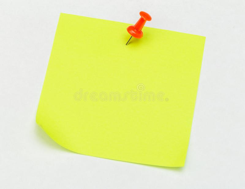 Note with a paper clip. Isolated on a white background stock image