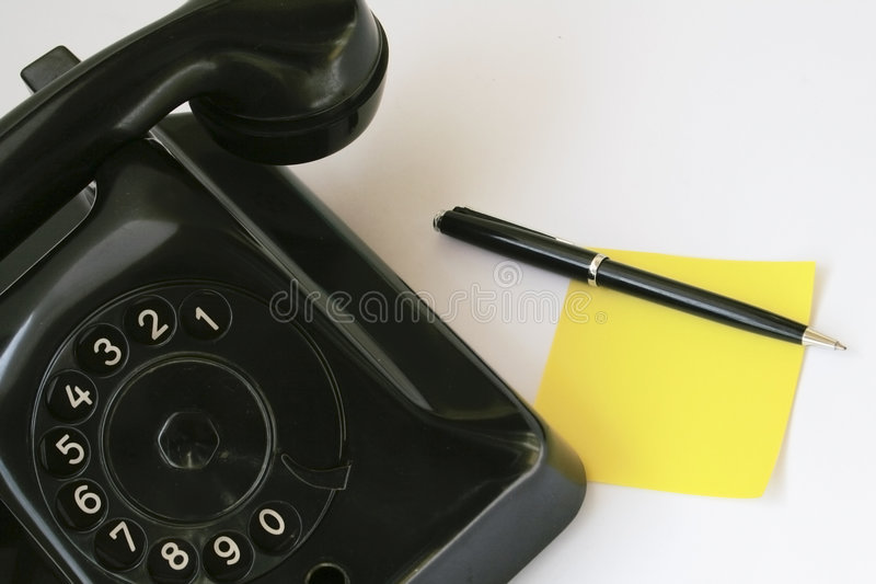 Note paper and pen with old phone royalty free stock photos