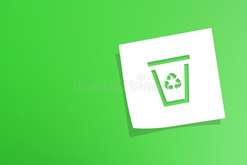 Note paper with recycle symbol on green background. Note paper with recycling symbol on green background royalty free stock photo