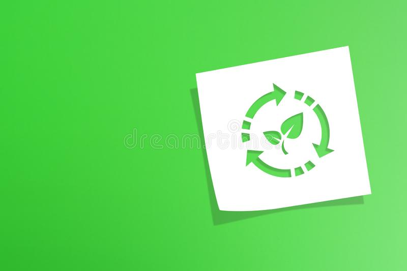Note paper with recycle symbol on green background. Note paper with recycling symbol on green background stock images