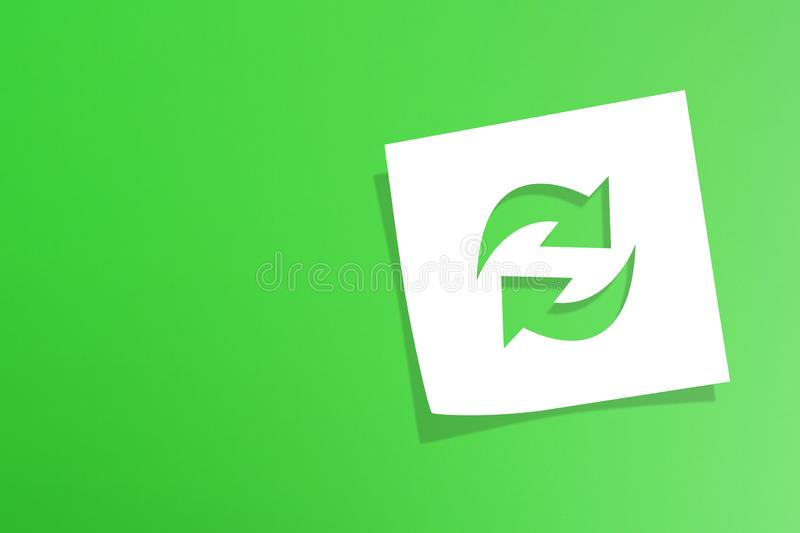 Note paper with recycle symbol on green background. Note paper with recycling symbol on green background royalty free stock photography