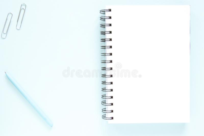 Note, pen, scoops, white page. Open note, blue pen, scoops on a flat lay background. Study concept stock photo