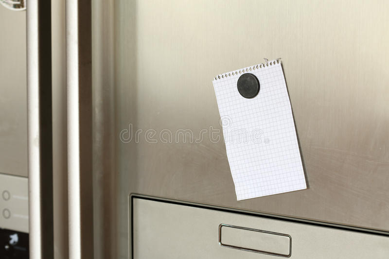 Note on refrigerator stock image