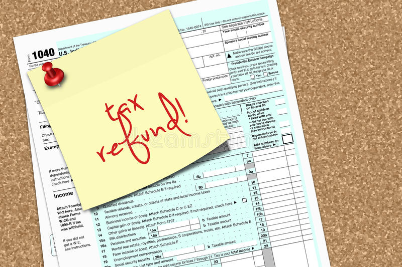 Note With Tax Refund Text And 1040 Form Pinned To Pin Board Stock