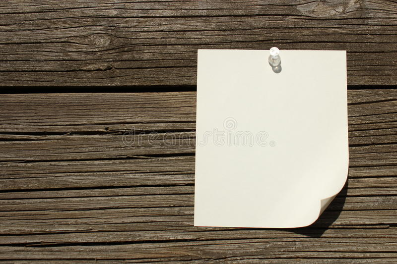 Note thumb tacked on wood stock photos