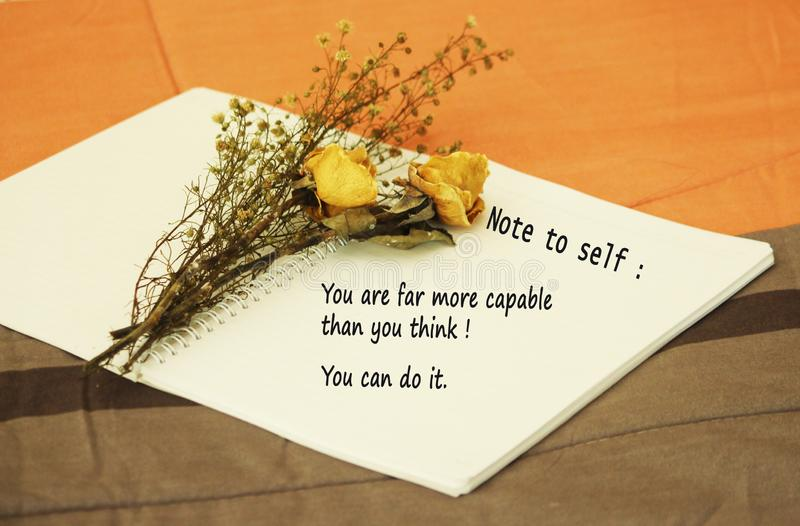 Note to self-you are far more capable than you think. You can do it. An inspirational & motivational quote concept with dried royalty free stock photos