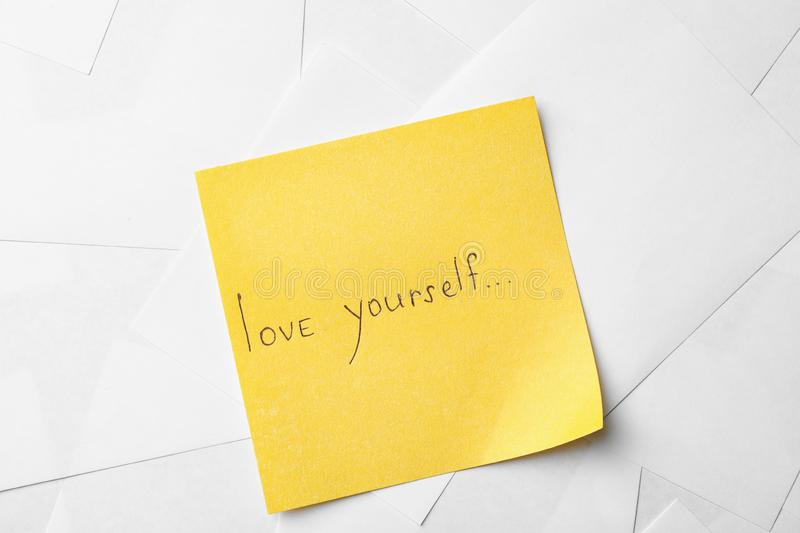 Note with words LOVE YOURSELF on paper sheets royalty free stock images