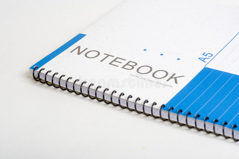 Notebook. A notebook in white background stock photography