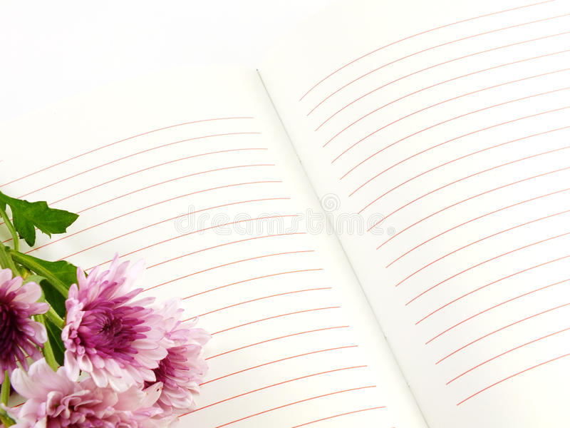 Notebook and beautiful chrysanthemums pink flowers bouquet royalty free stock photo