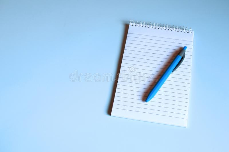 Notebook with blank pages on blue desk royalty free stock image