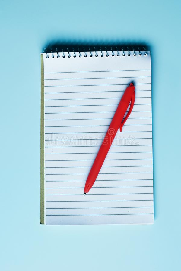 Notebook with blank pages and red pen royalty free stock photo