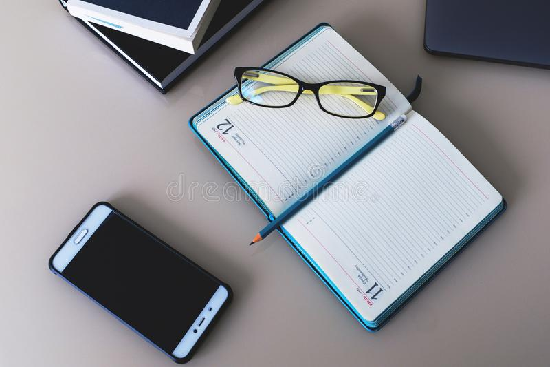 Notebook and books with a pen and glasses are on the table. Education. Business. Work stock photo