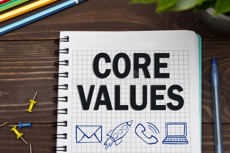 Notebook with a Business notes CORE VALUES on the office table w. Ith tools. Concept CORE VALUES with elements of infographics. conduct principle mission success stock illustration
