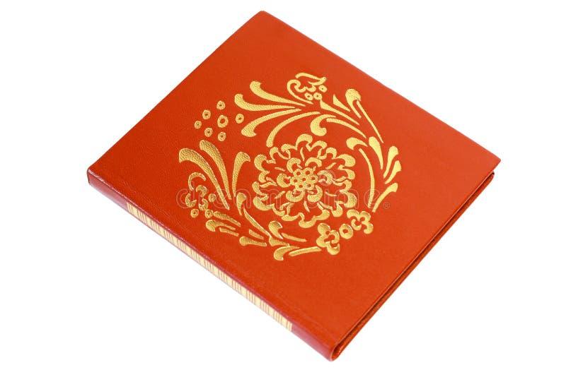 Notebook castanho com padrão dourado sobre fundo branco imagens de stock