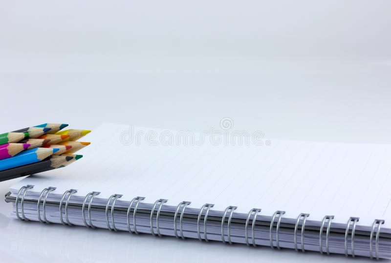 Notebook and color pencil. Isolate in white background stock photo