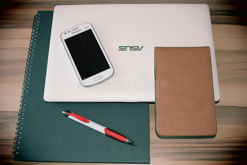Notebook, computer and mobile phone stock photography