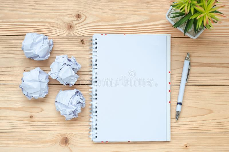 Notebook, crumbled paper, pen and on table. New Year Start, Creative, Idea, Resolution, Solution, Strategy and Mission. Concept stock photos