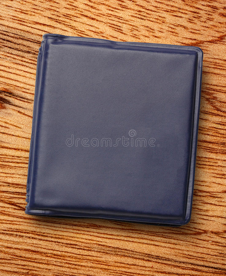 Notebook. Dark blue notebook on the wooden background stock photo