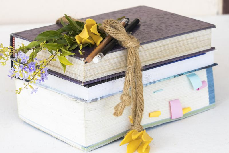Notebook ,dictionary book and pencil of student for study. Decoration on background white royalty free stock photos