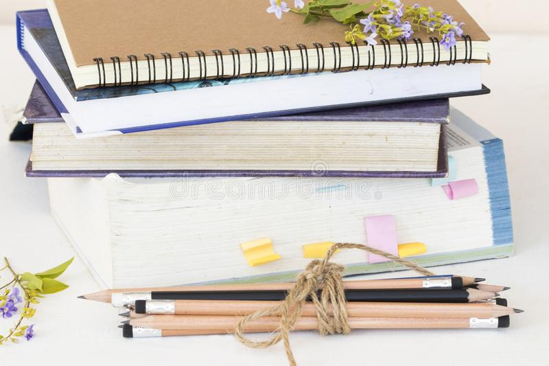 Notebook ,dictionary book and pencil of student for study. Decoration on background white stock photography