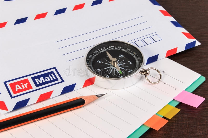Notebook, envelopes airmail, notebook, compass and pencil on woo. D floor. A close up view stock photography