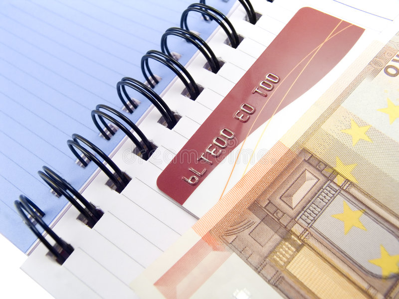 Notebook with Euro and a credit card royalty free stock photo