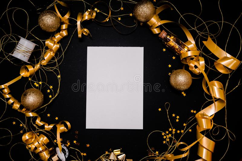 Blank notebook on pink coral background with Christmas decorations and sparkles. 2020. 2020 New Year concept copyspace top horizontal view royalty free stock images