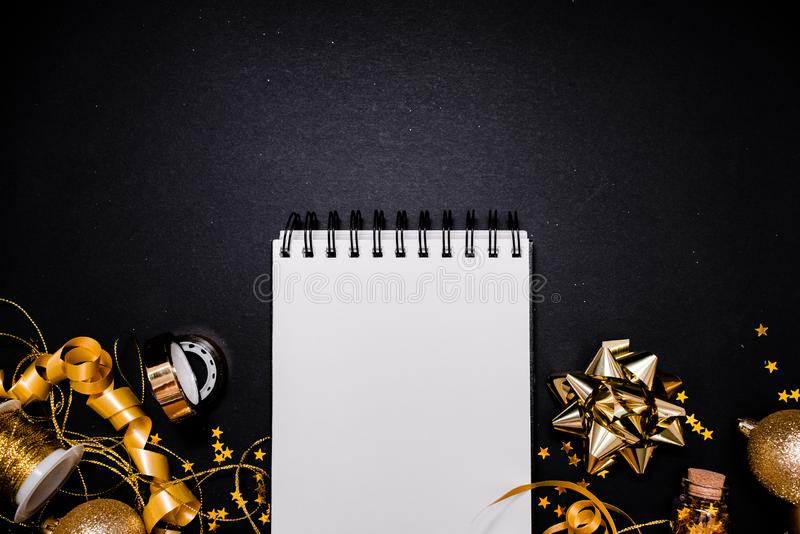 Blank notebook on pink coral background with Christmas decorations and sparkles. 2020. 2020 New Year concept copyspace top horizontal view stock photography