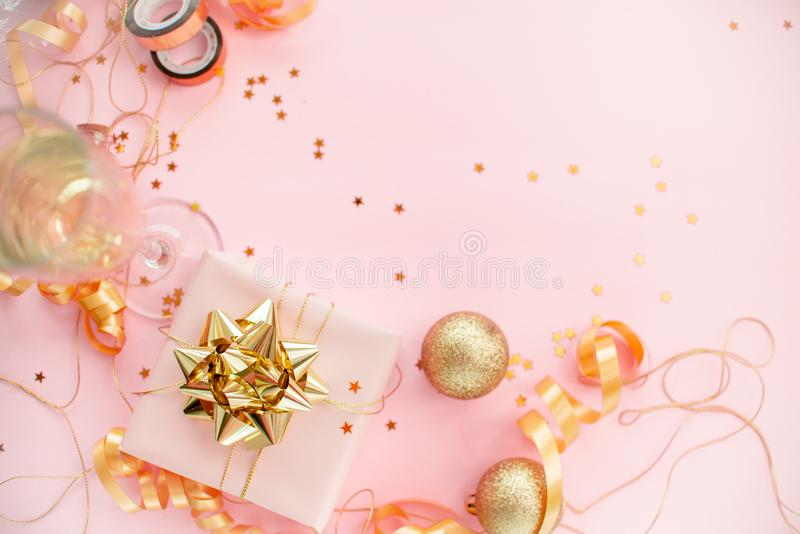 Notebook  with golden bow on pink coral background with stars and sparkles. Festive  and wish list . 2020 New Year concept copyspace top horizontal view stock photos