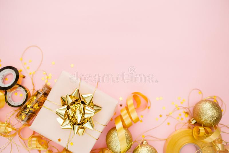 Notebook  with golden bow on pink coral background with stars and sparkles. Festive  and wish list . 2020 New Year concept copyspace top horizontal view stock images