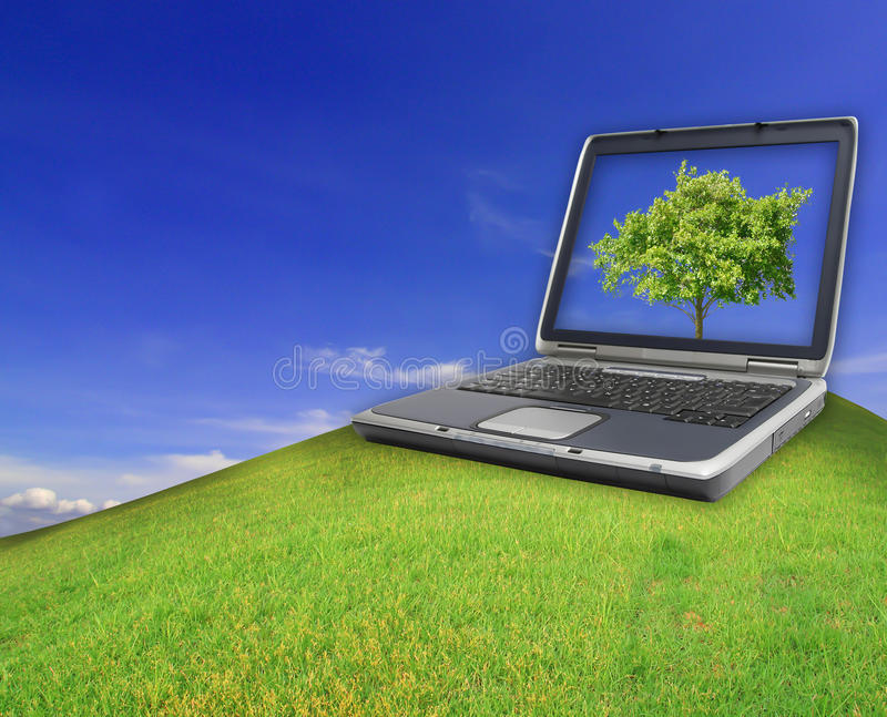 Notebook On The Green Field Of Spring Grass Royalty Free Stock Photo