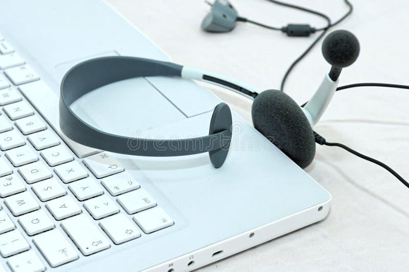 Notebook headset royalty free stock photos