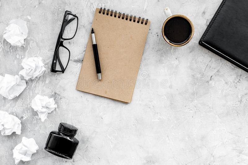 Notebook, ink, dip pen, coffee, glasses for writer workplace set on stone office background top view mock-up stock images
