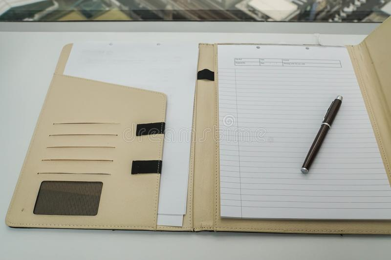 Notebook in leather case for memo and minute of meeting stock images