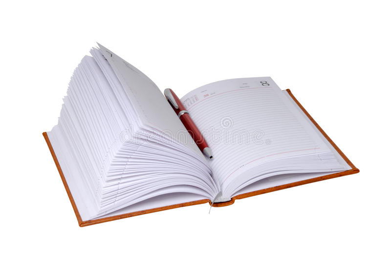 Notebook in leather cover and ball point pen. On a white background stock images