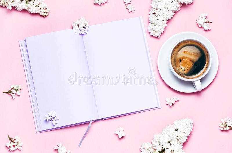 Notebook. lilac flowers and coffee cup stock photo