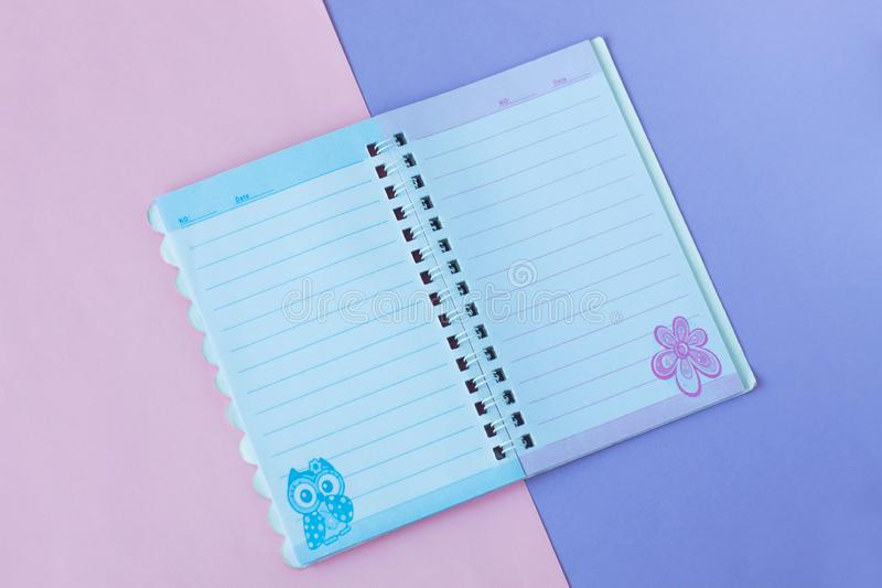 Notebook with lines. School stationery on a pink and purple duotone background royalty free stock images