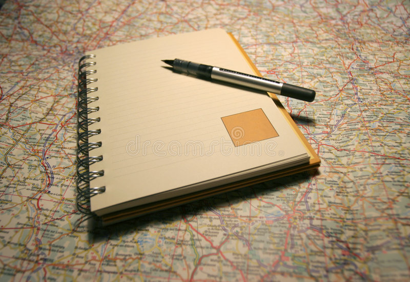 Notebook on a map royalty free stock image
