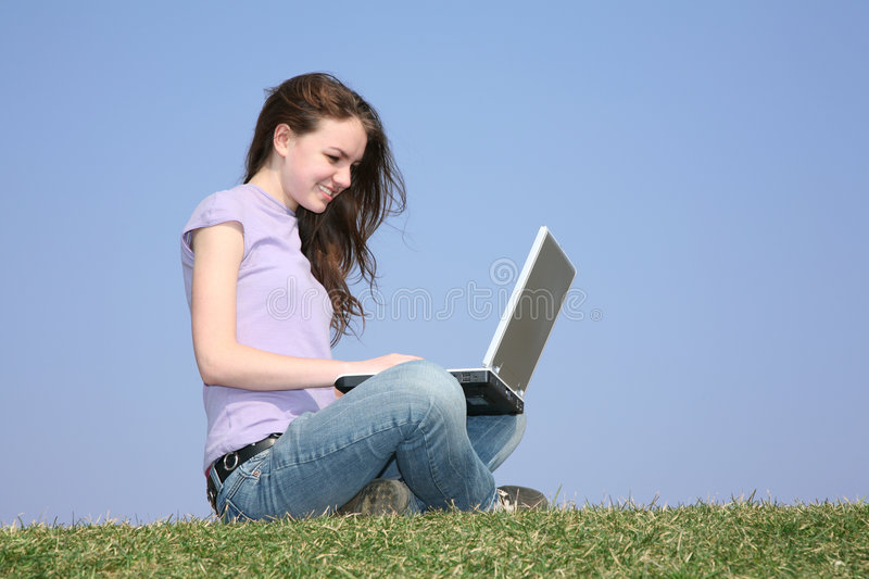 With notebook on meadow royalty free stock photo