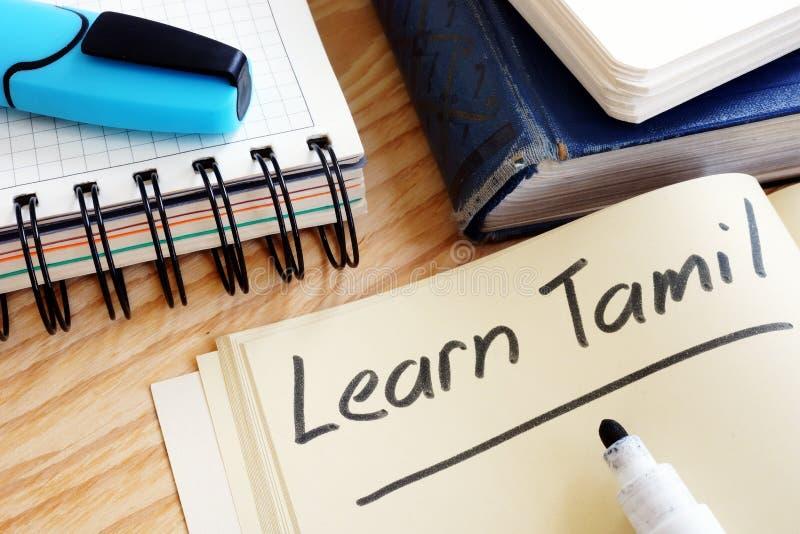 Notebook mit Schild Learn Tamil stockbild