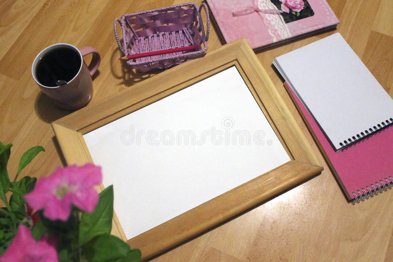 Notebook mock up for artwork with watercolor paints, palette, glass of water and a paintbrushes. Artistic work tools on royalty free stock photo