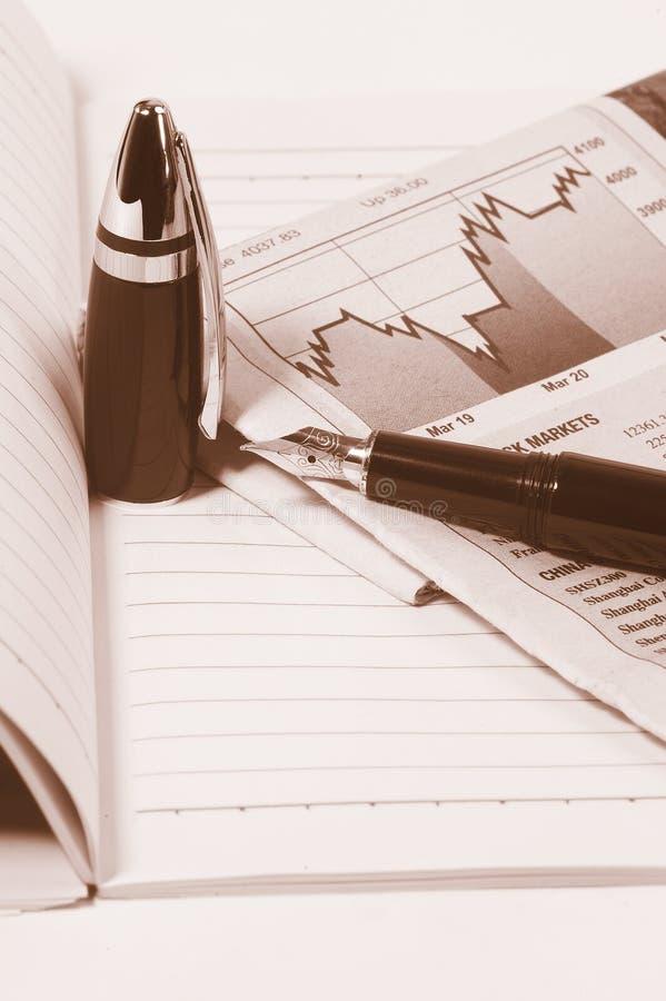 Notebook newspaper and pen stock photos