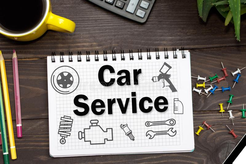 Notebook with a notes Car Service on the office table with tools royalty free illustration