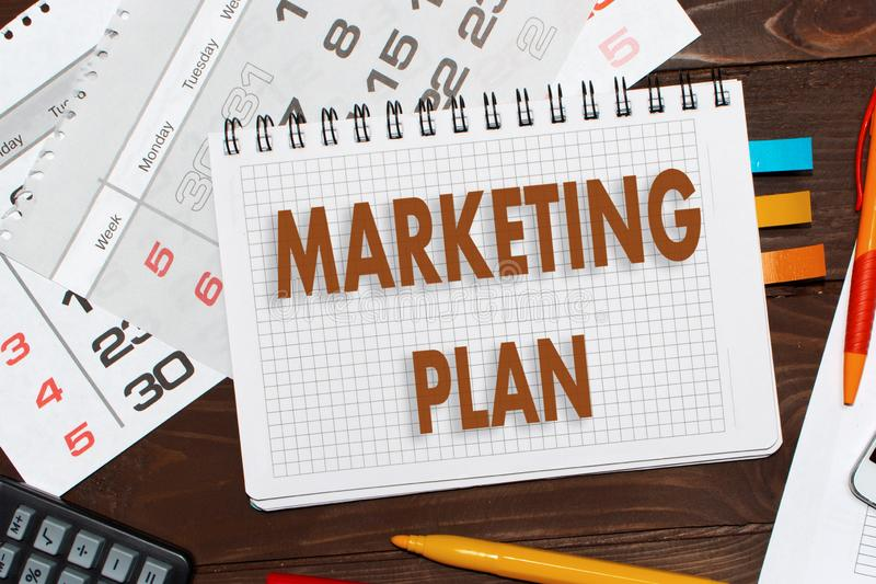 Notebook with a notes MARKETING PLAN on the office table with t vector illustration