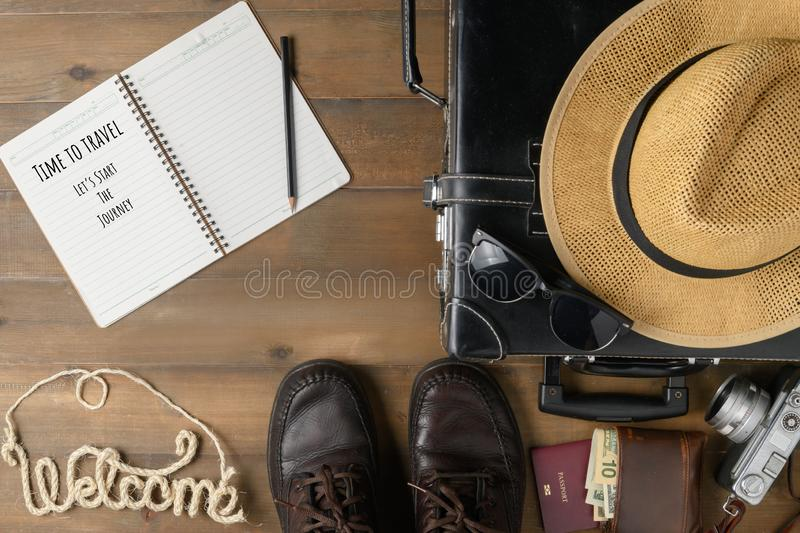 Notebook and Old black vintage suitcase stock image