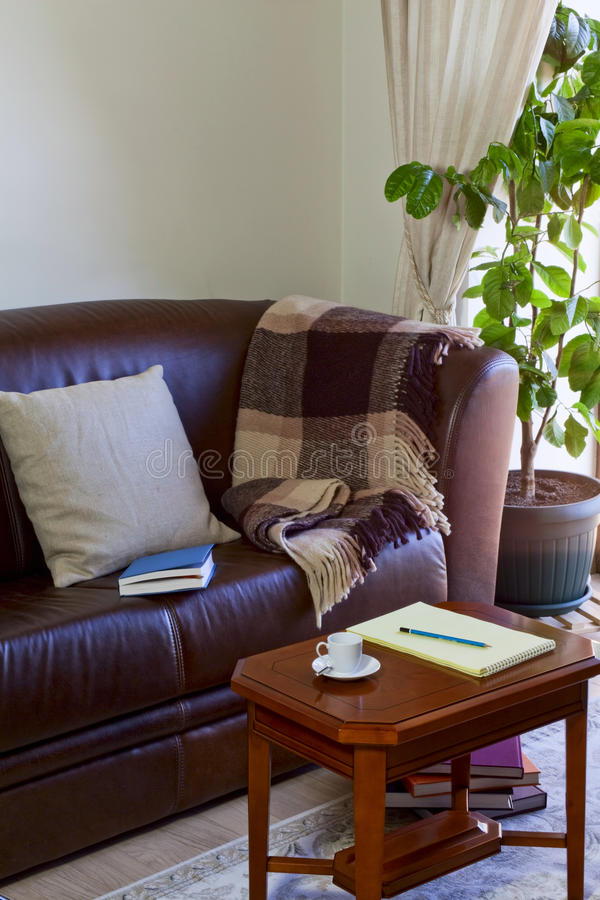Free Notebook On The Coffee Table And Couch Royalty Free Stock Photography - 31216867