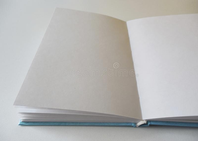 Notebook open. Book with blank sheets. Sketchbook for drawing. stock photo