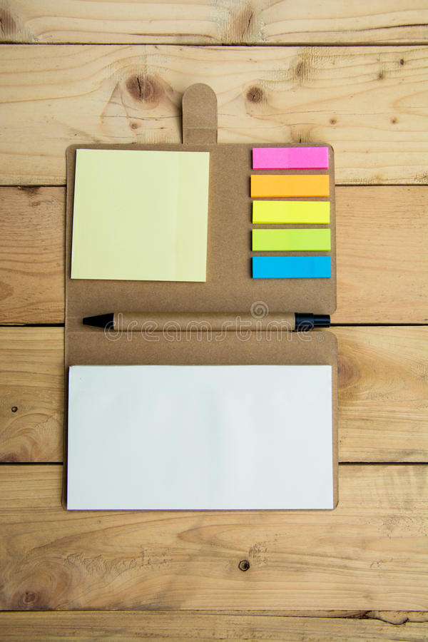 Download Notebook Paper Post It And Pen Top View On Wood Pallet Stock Photo