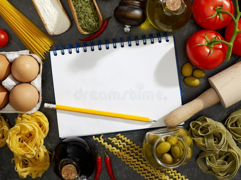 Notebook, pasta and ingredients stock images