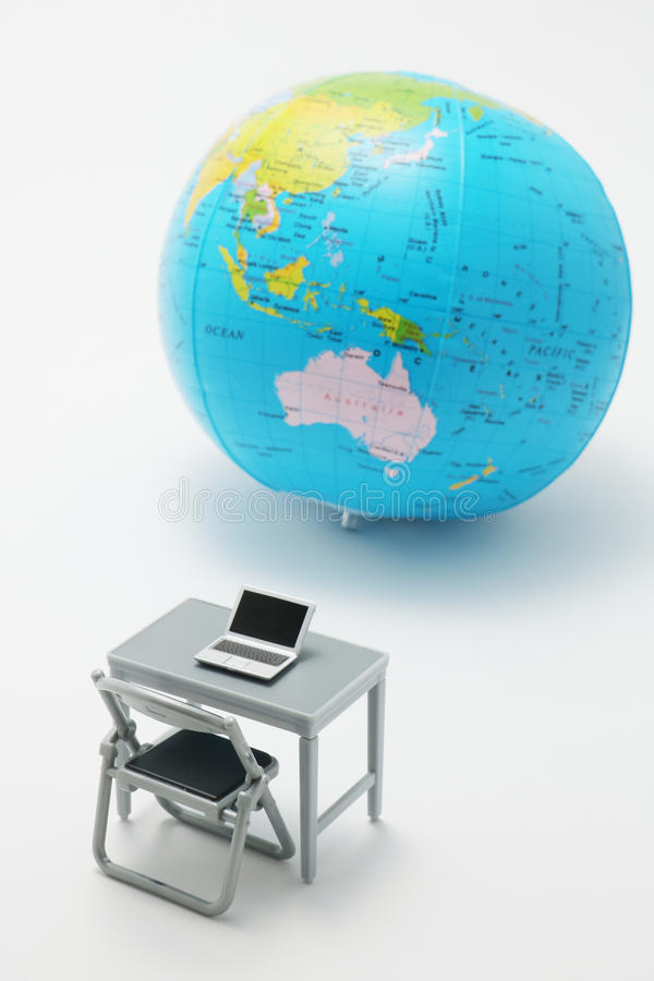 Notebook PC and globe on white background. Miniature notebook PC and globe on white background stock photos
